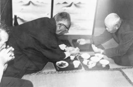 Otaiya Ceremony in observance of Christmas eve, during which a Kakure Kirishitan priest places a ball of rice in the palm of another priest in a rite reminiscent of the Eucharist. photo by Christal Whelan